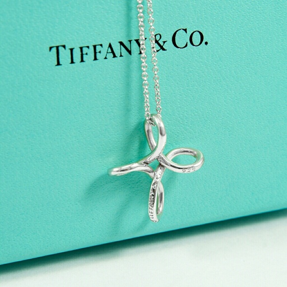 28ca8a78f Tiffany & Co. Elsa Peretti Infinity Cross Pendant.  M_5b0df49acaab440ea7808e7d. Other Jewelry ...